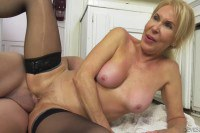 Erica Lauren blonde mature in stockings gets fucked by a young bank clerk