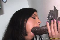 Missy Maze skilled brunette sucks and fucks a huge black dick at the gloryhole