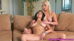 Xandra Sixx and Darcie Dolce two busty lesbians having fun on the couch