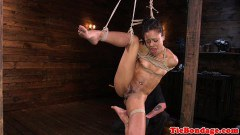 Restrained black bondage slave vulva toyed