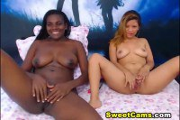 Nubian and white lesbos with big boobs have fun on webcam
