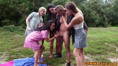 Femdoms jacking CFNM sex slave outdoors in group sex