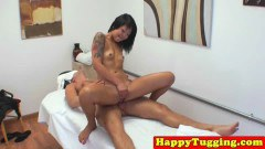Tattooed oriental masseuse rides dick on spycam