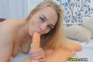 Blonde nympho with nice boobs sucks and fucks her new dildo