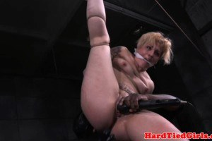 Inked chick toyed and restrained by master