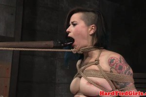 Tattoo model spanked and throated by sadistic master