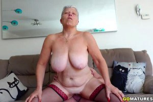 Busty grandma sucks and rides boy toy's big fat cock