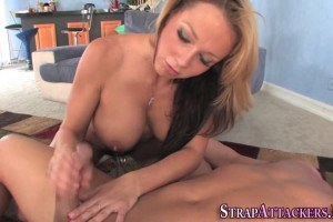 Busty strapon dominatrix wanks her sub