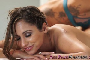 Enticing brunette gets pleasured by lesbo during massage