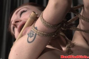 Young sex slave hogtied while toying her cunt