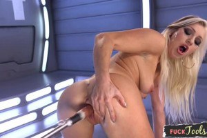 Ravishing blonde with perfect breasts gets fucked by a machine
