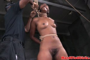 Breast bound nubian female is restrained by dom