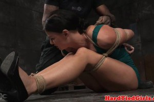 Sexy flexible babe is contorted by rope