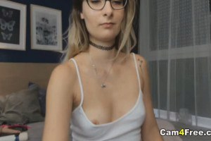 Sweet nerd with spex strips and plays with her wet cunt