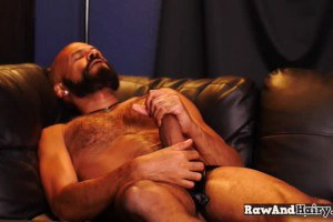 Bearded otter tugging off his shaft