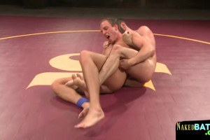 Muscular studs wrestling and teasing