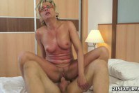Sexy blonde granny does a young cock