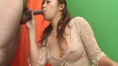 Busty oriental sucking on two cocks