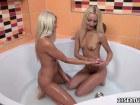 Skinny blonde beauties makign love in the bathroom