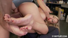 Busty chick in footjob and hard garage fuck