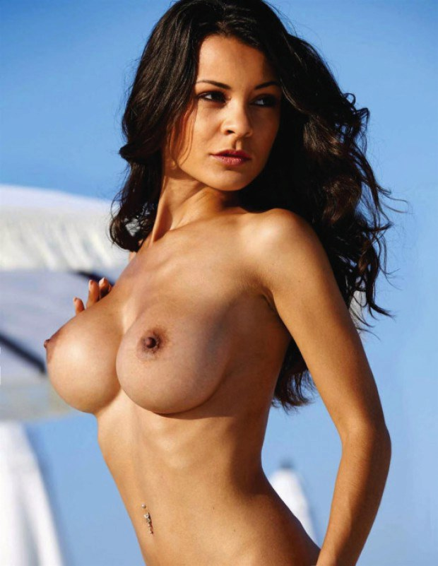Fabulous brunette is topless outdoors