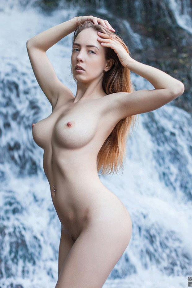 Ginger babe shows off her perfect tits