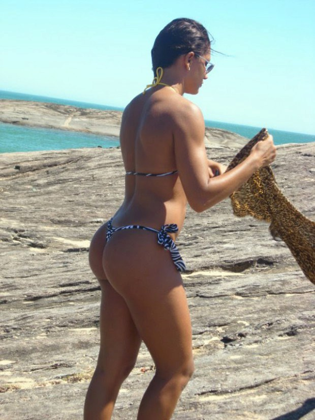 Perfect ass babe teases on a rock