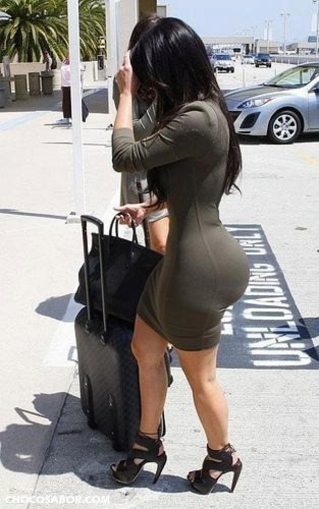 Big booty brunette carries her luggage
