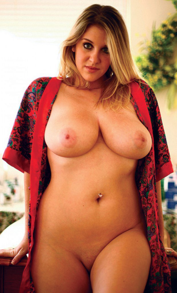 Chubby blonde babe has massive jugs and navel piercing
