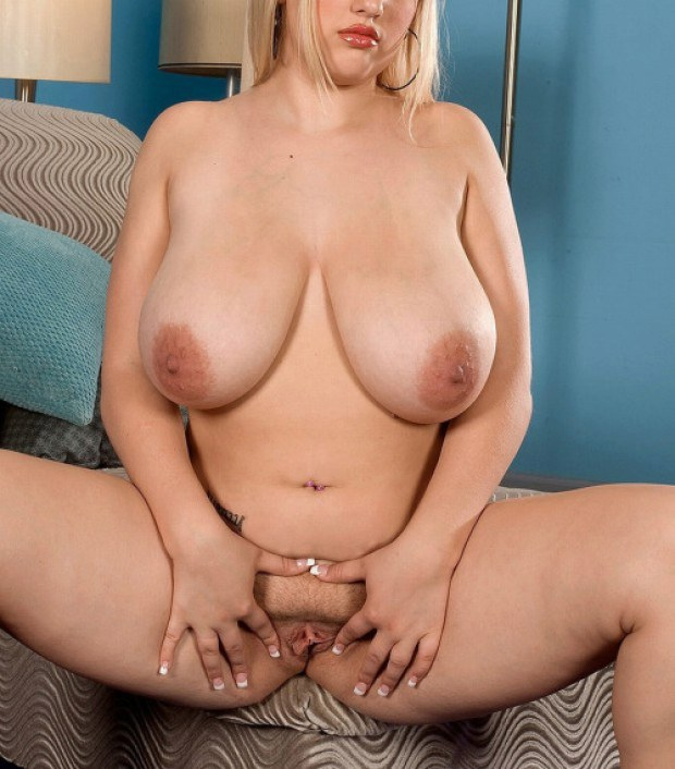 Chubby blonde with huge titties stretches her snatch