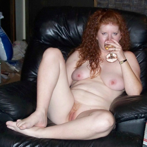 Nude wife on couch
