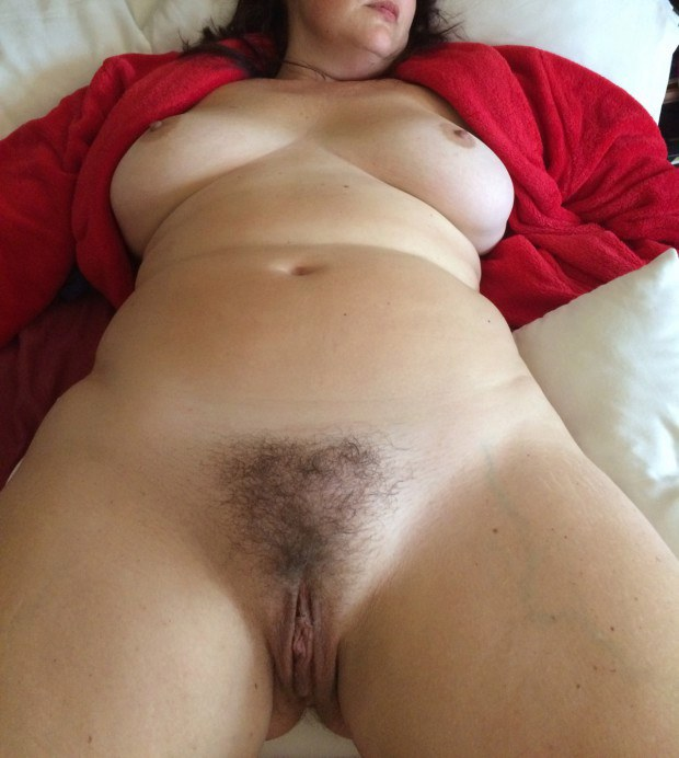 Curvy wife shows her hairy muff and nice tits