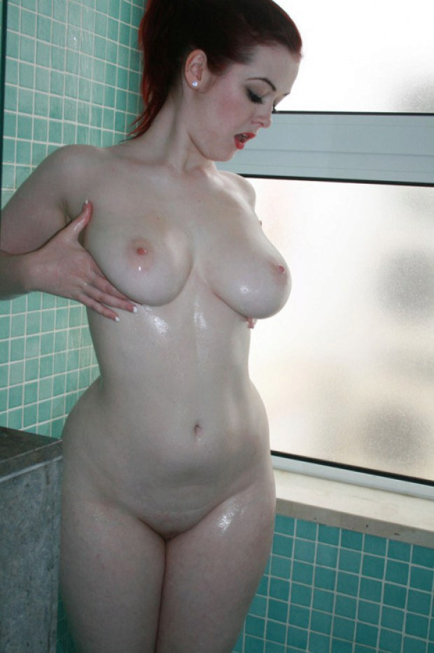 Stunning redhead is proud of her perfect breasts