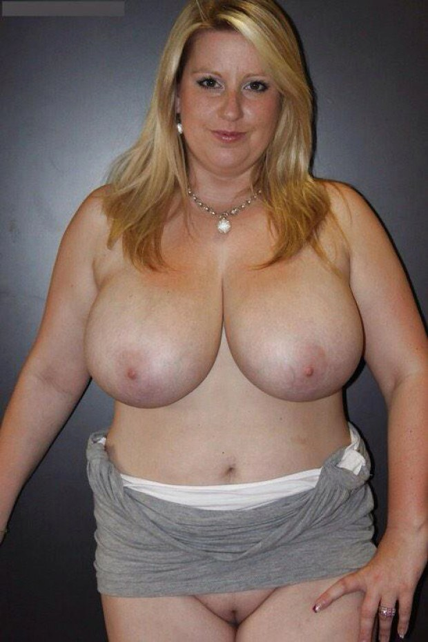 Chubby blonde exposes her huge melons and shaved twat