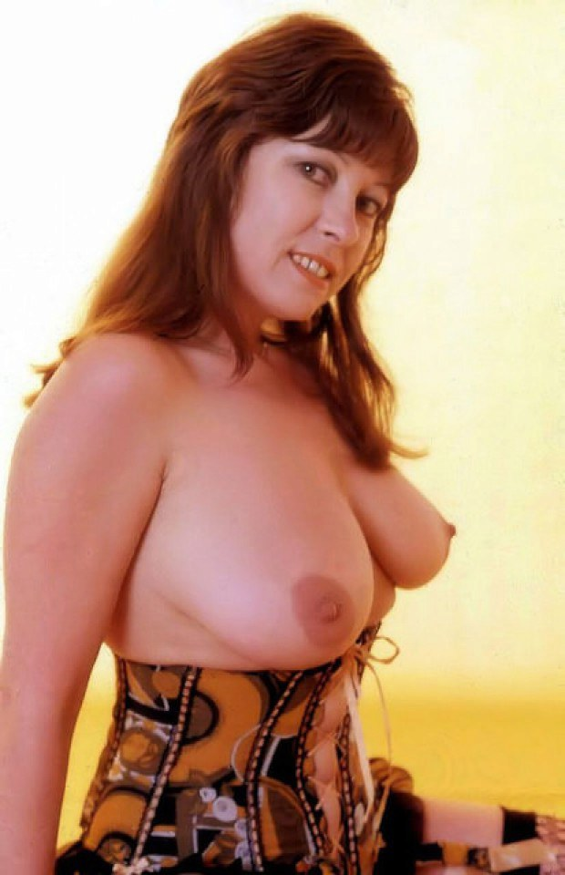 Busty retro redhead presents her massive tits