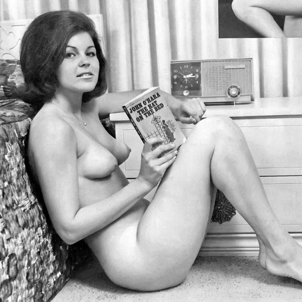 Vintage MILF from 60s reading a magazine