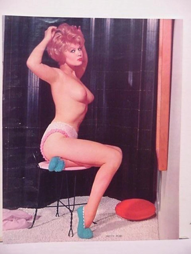 Retro pin-up model presents her titties