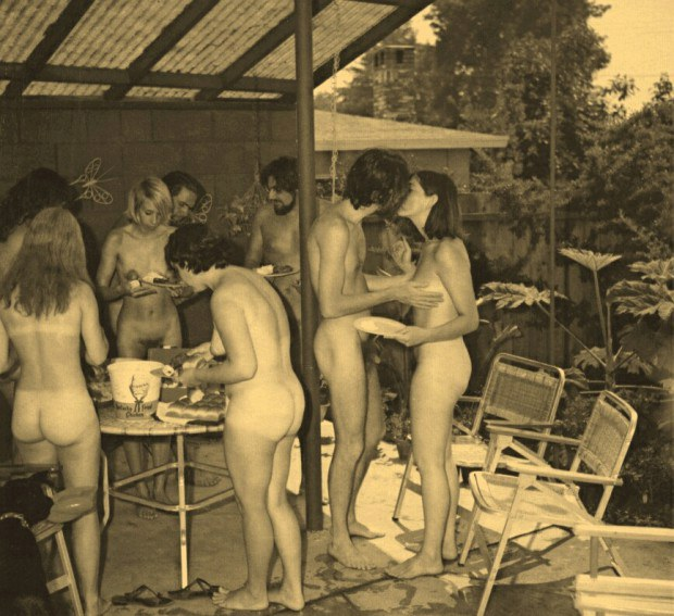 Retro nudists having fun at a pool party