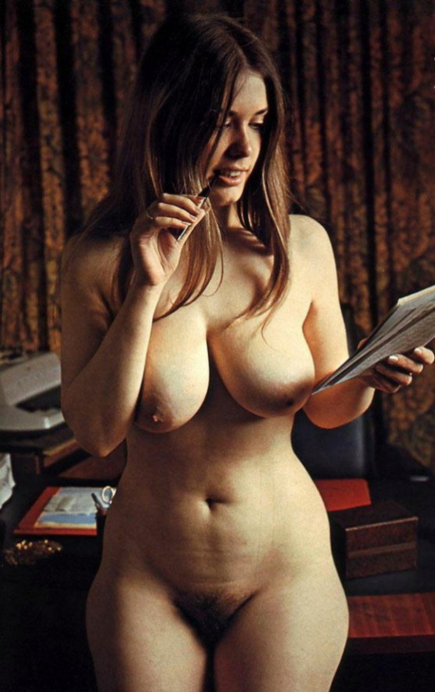 Busty retro brunette reading an article