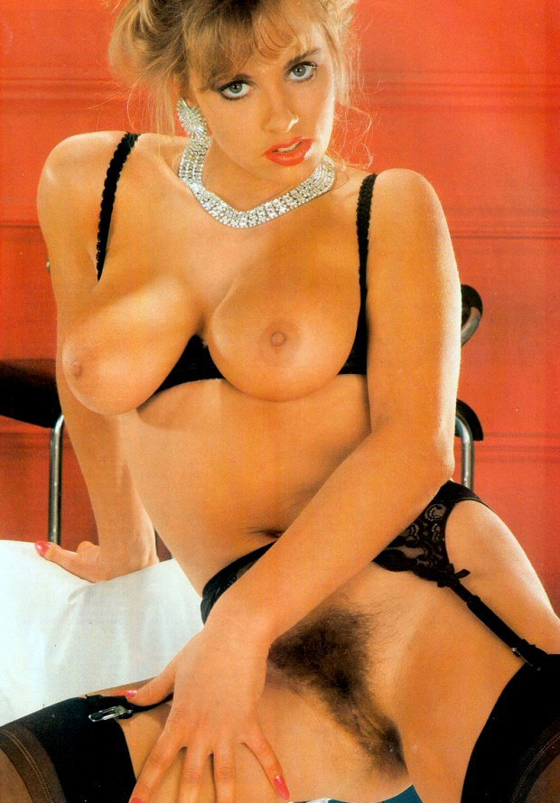 Busty retro blonde in lingerie shows her hairy twat
