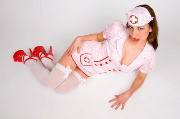 Naughty nurse on high heels has the perfect cleavage