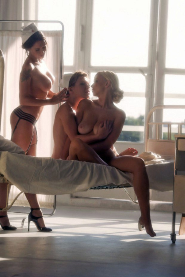 Two hot nurses take care of their blond patient