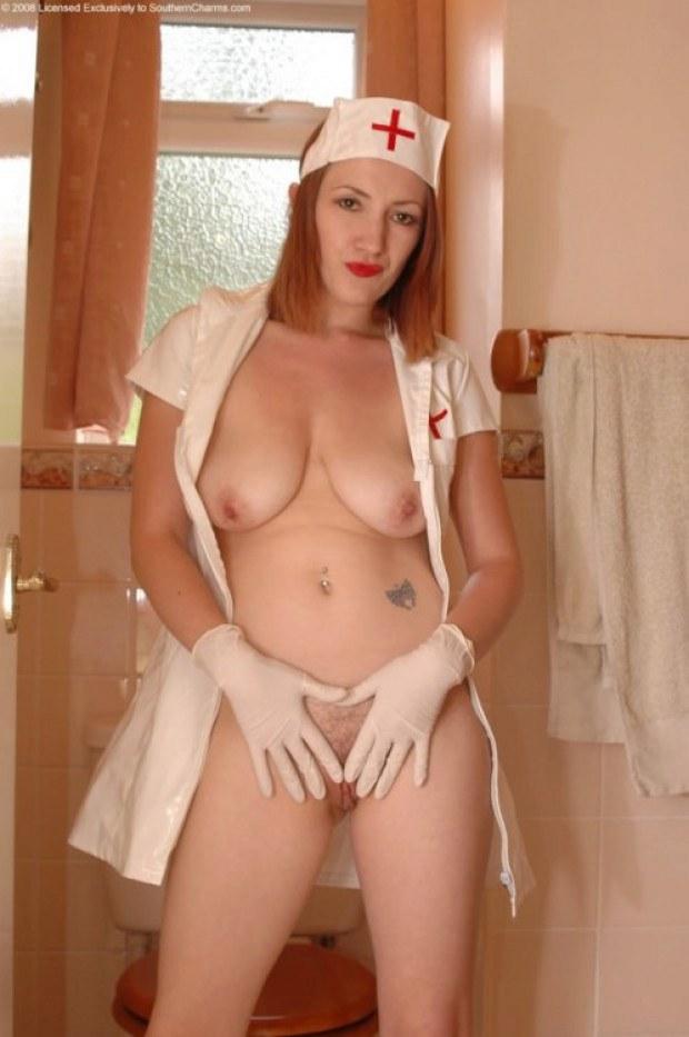 Slutty redhead nurse presents her twat and titties