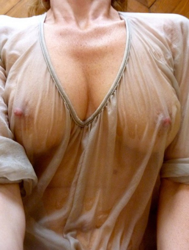 Those tits look perfect behind the wet shirt