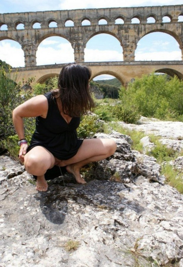 Women pees under the viaduct