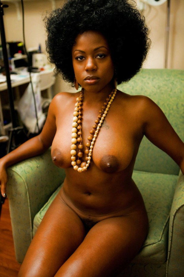 Curly haired ebony MILF with big natural jugs