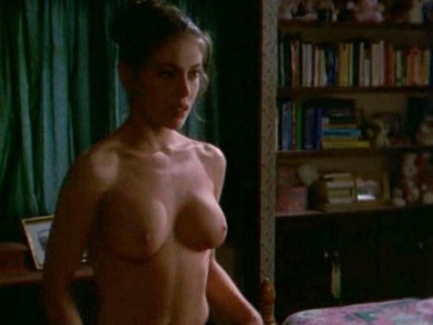 Beautiful brunette Alyssa Milano shows her boobies