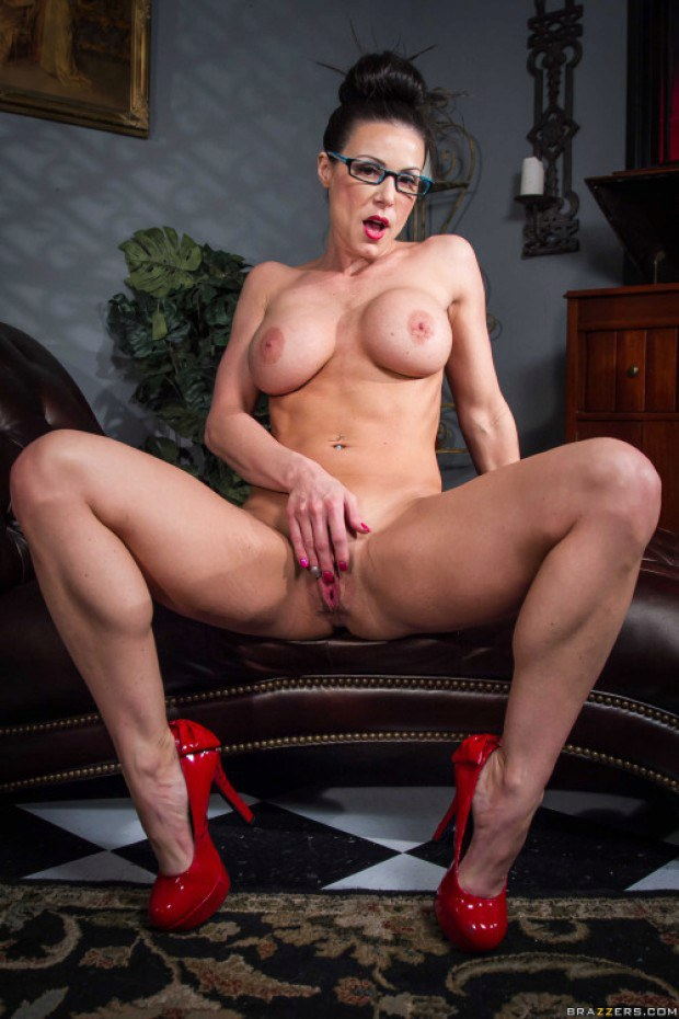 MILF with glasses rubs her pussy