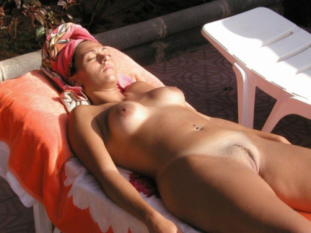Nudist wife catches some sun on the terrace
