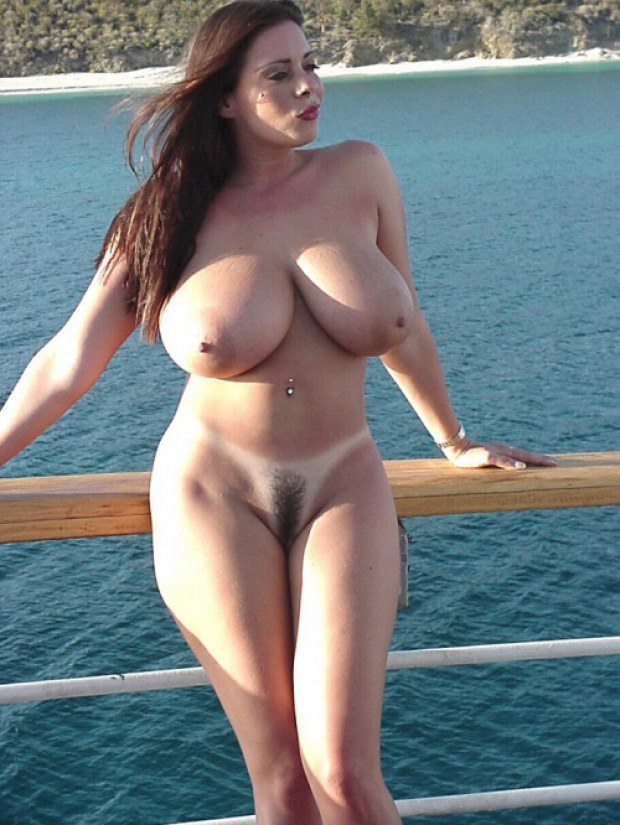Busty and beautiful babe teases on the pier
